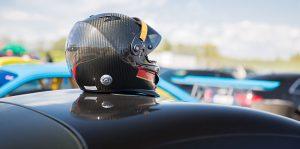 A NASCAR racer's helmt on top of a car.
