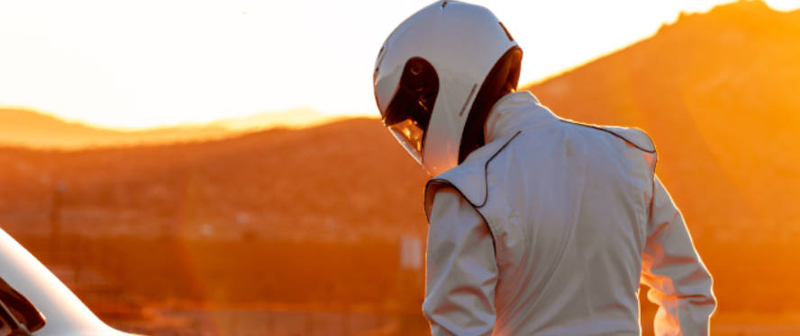 a-nascar-driver-at-sunset-with-helmet-on