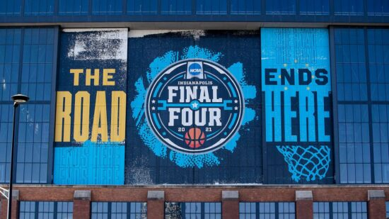 Signs on the side of Lucas Oil Stadium promote the NCAA March Madness tournament on Thursday, March 4, 2021, in Indianapolis. Ncaa March Madness And Big Ten Basketball Courts Inside Lucas Oil Stadium In Indianapolis March 4 2021
