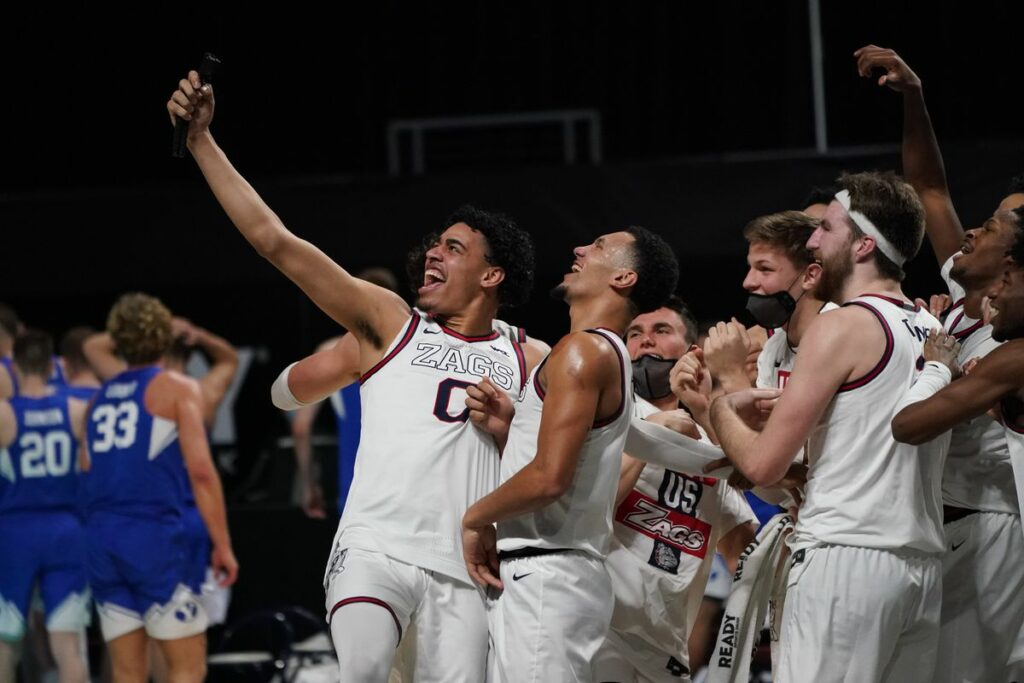 Mar 9, 2021; Las Vegas, NV, USA; Gonzaga Bulldogs forward Corey Kispert (24), guard Julian Strawther (0), guard Jalen Suggs (1) and forward Drew Timme (2) celebrate after defeating the the BYU Cougars in the West Coast Conference Tournament championship game at Orleans Arena. Mandatory Credit: Kirby Lee-USA TODAY Sports