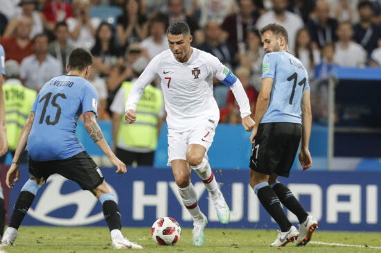 Jun 30, 2018; Sochi, Russia; Portugal player Cristiano Ronaldo (7) controls the ball against Uruguay players Cristhian Stuani (11) and Matias Vecino (15) in the round of 16 during the FIFA World Cup 2018 at Fihst Stadium. Mandatory Credit: Leonel de Castro/Global Images/Sipa USA via USA TODAY Sports