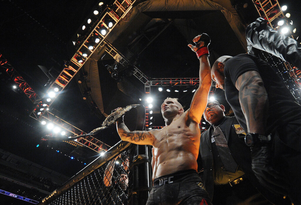 August 4, 2018; Los Angeles, CA, USA; TJ Dillashaw celebrates his championship victory against Cody Garbrandt during UFC 227 at Staples Center. Mandatory Credit: Gary A. Vasquez-USA TODAY Sports