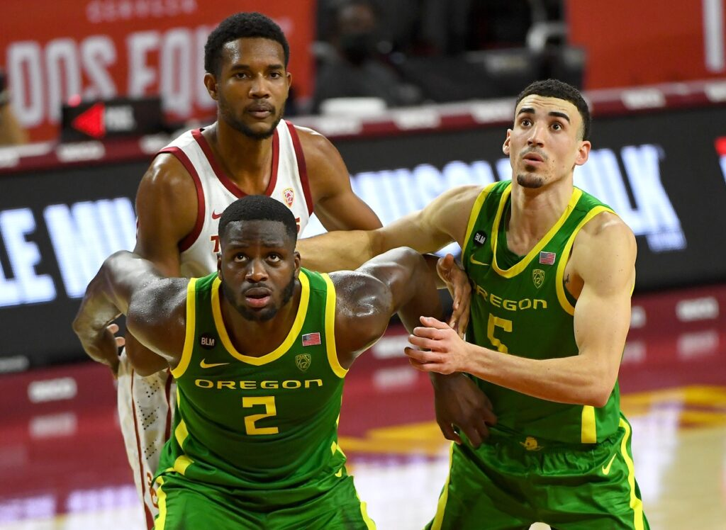 Feb 22, 2021; Los Angeles, California, USA; Oregon Ducks forward Eugene Omoruyi (2) and Chris Duarte (5) box out USC Trojans forward Evan Mobley (4) in the first half of the game at Galen Center. Mandatory Credit: Jayne Kamin-Oncea-USA TODAY Sports