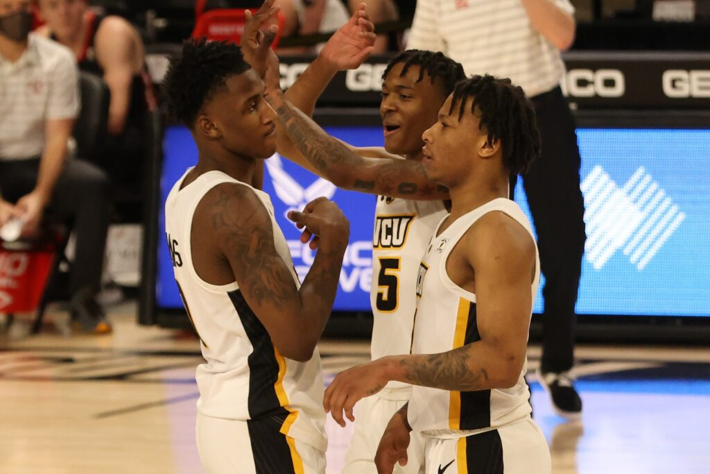 Mar 6, 2021; Richmond, Virginia, USA; VCU Rams forward Jamir Watkins (0) celebrates with Rams guard Nah'Shon Hyland (5) and Rams guard Adrian Baldwin Jr. (1) against the d/ in the second half in a semifinal of the Atlantic 10 conference tournament at Stuart C. Siegel Center. Mandatory Credit: Geoff Burke-USA TODAY Sports