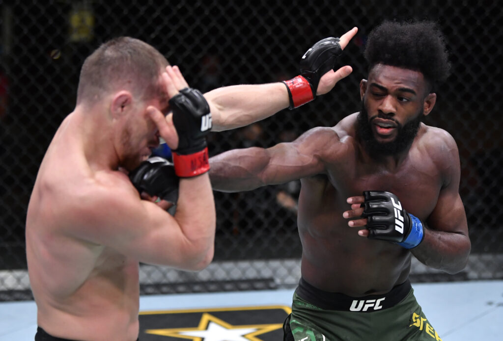Mar 6, 2021; Las Vegas, NV, USA; Aljamain Sterling punches Petr Yan of Russia in their UFC bantamweight championship fight during the UFC 259 event at UFC APEX on March 06, 2021 in Las Vegas, Nevada.  Mandatory Credit: Jeff Bottari/Handout Photo via USA TODAY Sports