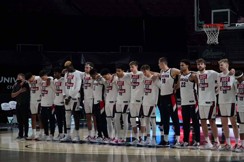 Mar 8, 2021; Las Vegas, NV, USA; Gonzaga Bulldogs coach Mark Few and players stand during the playing of the national anthem before a West Coast Conference tournament semifinal against the St. Mary's Gaels at Orleans Arena. Mandatory Credit: Kirby Lee-USA TODAY Sports
