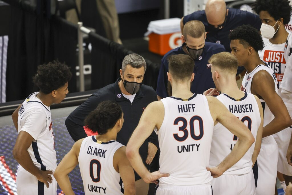 Mar 11, 2021; Greensboro, North Carolina, USA; Virginia Cavaliers head coach Tony Bennett talks to his team during a timeout as his team plays the Syracuse Orange during the second half in the quarterfinal round of the 2021 ACC tournament at Greensboro Coliseum. The Virginia Cavaliers won 72-69.  Mandatory Credit: Nell Redmond-USA TODAY Sports