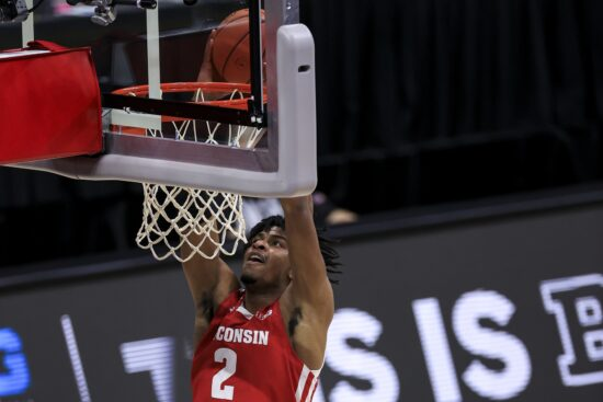 Mar 12, 2021; Indianapolis, Indiana, USA; Wisconsin Badgers forward Aleem Ford (2) dunks the ball against the Iowa Hawkeyes in the first half at Lucas Oil Stadium. Mandatory Credit: Aaron Doster-USA TODAY Sports