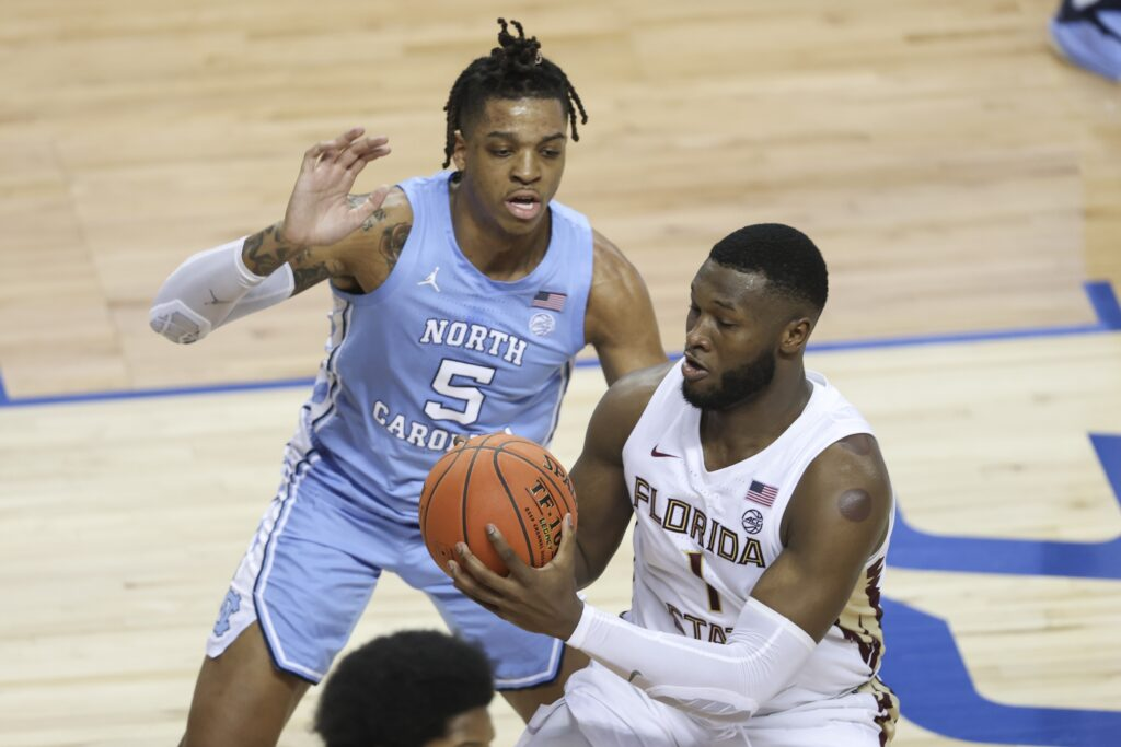 Mar 12, 2021; Greensboro, North Carolina, USA; Florida State Seminoles forward RaiQuan Gray (1) drives to the basket against North Carolina Tar Heels forward Armando Bacot (5) during the second half in the 2021 ACC tournament semifinal game at Greensboro Coliseum. The Florida State Seminoles won 69-66. Mandatory Credit: Nell Redmond-USA TODAY Sports