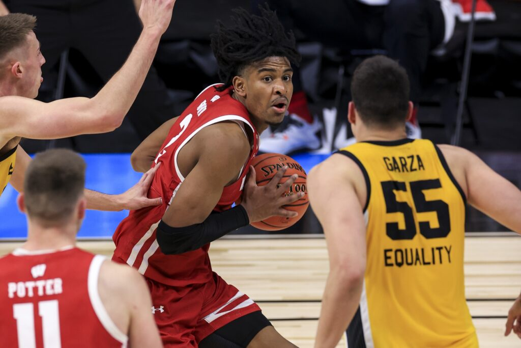 Mar 12, 2021; Indianapolis, Indiana, USA; Wisconsin Badgers forward Aleem Ford (2) drives to the basket against the Iowa Hawkeyes in the second half at Lucas Oil Stadium. Mandatory Credit: Aaron Doster-USA TODAY Sports