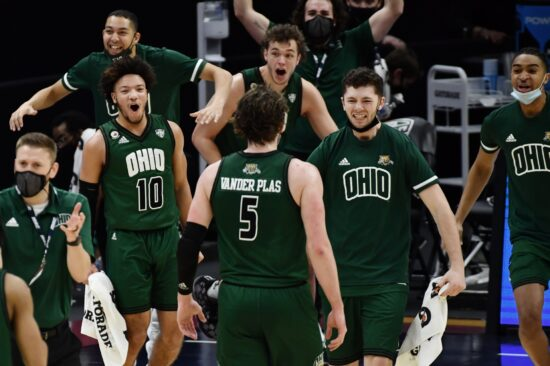 Mar 13, 2021; Cleveland, Ohio, USA; The Ohio Bobcats bench celebrates after a basket by forward Ben Vander Plas (5) during the first half against the Buffalo Bulls at Rocket Mortgage FieldHouse. Mandatory Credit: Ken Blaze-USA TODAY Sports