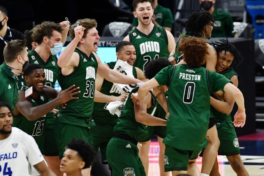 Mar 13, 2021; Cleveland, Ohio, USA;  Ohio Bobcats players celebrate after the Bobcats beat the Buffalo Bulls to win the MAC championship at Rocket Mortgage FieldHouse. Mandatory Credit: Ken Blaze-USA TODAY Sports