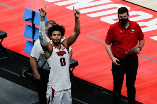 Arkansas Razorbacks forward Justin Smith (0) raises his arms to the student section after defeating the Colgate Raiders 85-68 during the first round of the 2021 NCAA Tournament on Friday, March 19, 2021, at Bankers Life Fieldhouse in Indianapolis, Ind. Mandatory Credit: Adam Cairns/IndyStar via USA TODAY Sports