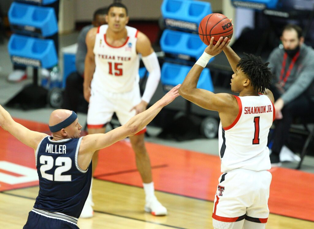 Mar 19, 2021; Bloomington, Indiana, USA; Texas Tech Red Raiders guard Terrence Shannon Jr. (1) shoots against Utah State Aggies guard Brock Miller (22) during the second half in the first round of the 2021 NCAA Tournament at Simon Skjodt Assembly Hall. Mandatory Credit: Jordan Prather-USA TODAY Sports