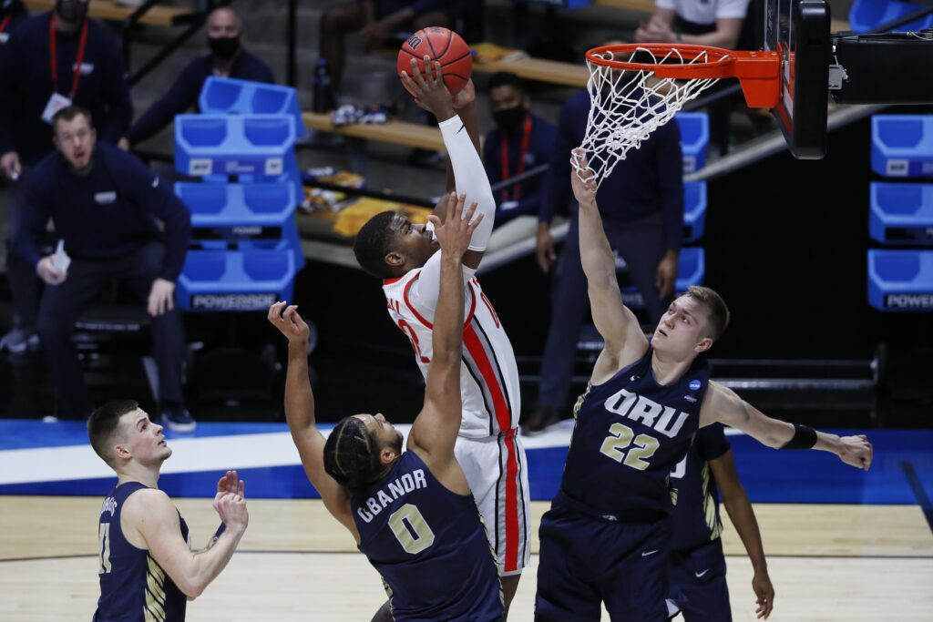 Mar 19, 2021; West Lafayette, Indiana, USA; Ohio State Buckeyes forward E.J. Liddell (32) shoots the ball over Oral Roberts Golden Eagles guard Carlos Jurgens (11) and forward Kevin Obanor (0) and forward Francis Lacis (22) during the first half in the first round of the 2021 NCAA Tournament at Mackey Arena. Mandatory Credit: Joshua Bickel-USA TODAY Sports