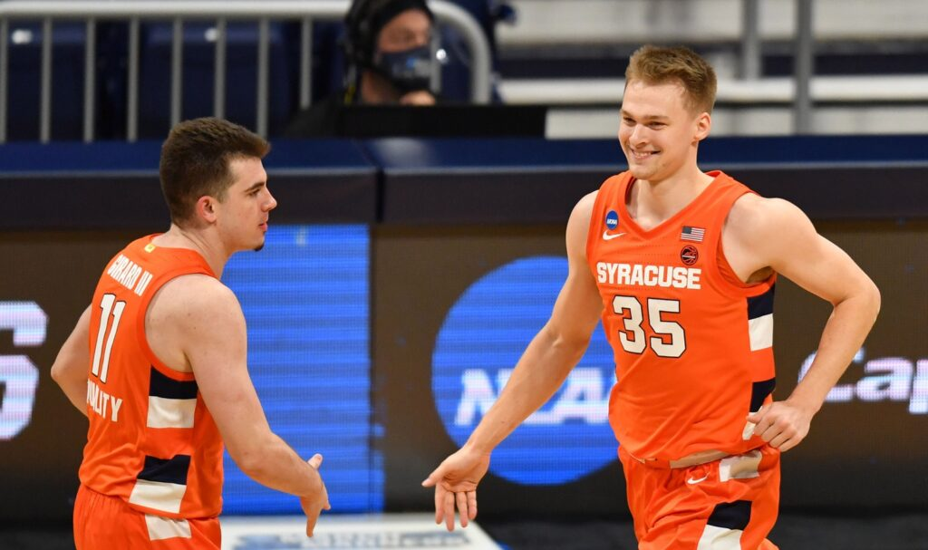 Mar 19, 2021; Indianapolis, Indiana, USA; Syracuse Orange guard Buddy Boeheim (35) celebrates with guard Joseph Girard III (11) against the San Diego State Aztecs during the first round of the 2021 NCAA Tournament at Hinkle Fieldhouse. Mandatory Credit: Patrick Gorski-USA TODAY Sports