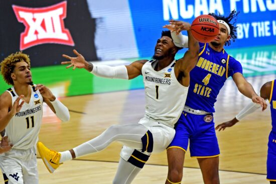 Mar 19, 2021; Indianapolis, Indiana, USA; West Virginia Mountaineers forward Derek Culver (1) and m4 go for a rebound during the second half in the first round of the 2021 NCAA Tournament at Lucas Oil Stadium. Mandatory Credit: Christopher Hanewinckel-USA TODAY Sports