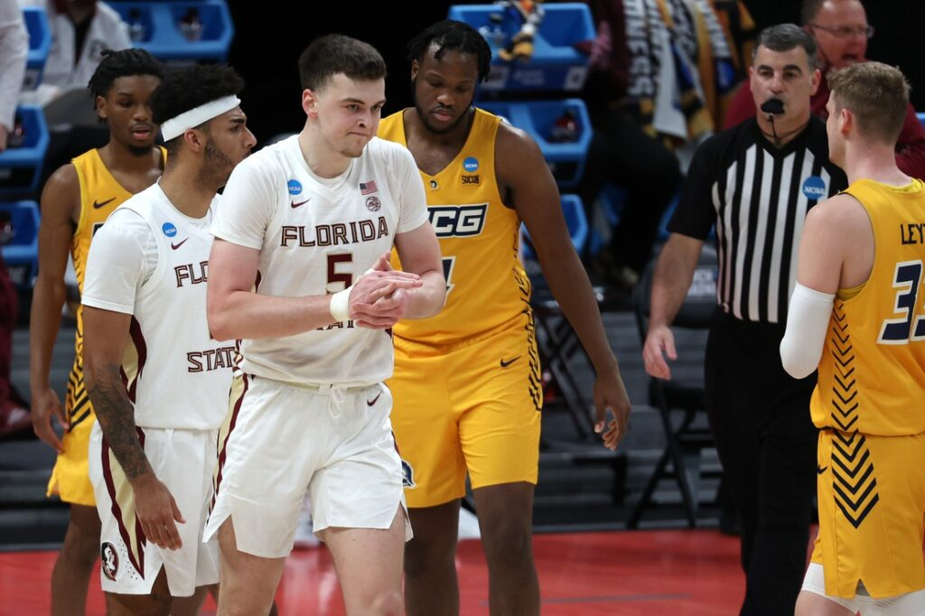 Mar 20, 2021; Indianapolis, Indiana, USA; Florida State Seminoles center Balsa Koprivica (5) reacts against the UNCG Spartans during the second half in the first round of the 2021 NCAA Tournament at Bankers Life Fieldhouse. Mandatory Credit: Trevor Ruszkowski-USA TODAY Sports