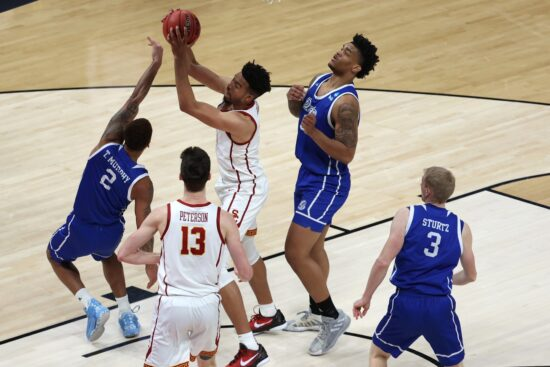Mar 20, 2021; Indianapolis, Indiana, USA; Southern California Trojans forward Isaiah Mobley (3) grabs a rebound ahead of Drake Bulldogs forward Tremell Murphy (2) during the second half in the first round of the 2021 NCAA Tournament at Bankers Life Fieldhouse. Mandatory Credit: Trevor Ruszkowski-USA TODAY Sports