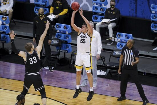 Mar 20, 2021; Indianapolis, IN, USA; Iowa Hawkeyes center Luka Garza (55) makes a three point shot over Grand Canyon Antelopes center Asbj¿rn Midtgaard (33) during the first round of the 2021 NCAA Tournament at Indiana Farmers Coliseum.  Mandatory Credit: Katie Stratman-USA TODAY Sports