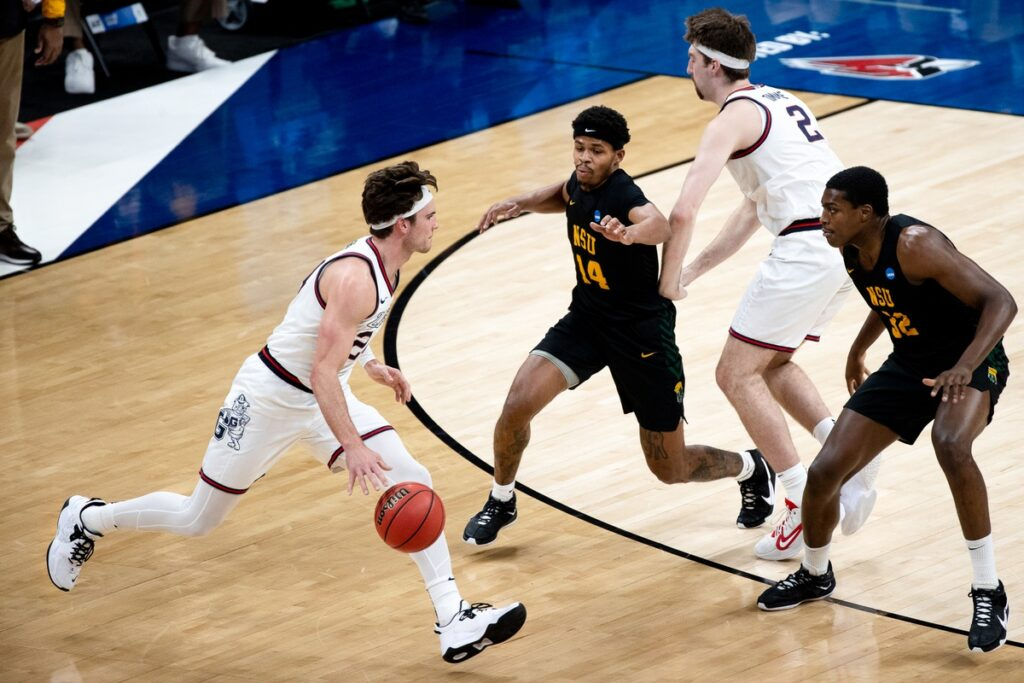 Gonzaga forward Corey Kispert (24) dribbles the ball as Norfolk State guard Devante Carter (14) and forward Chris Ford (32) defend during the first round of the 2021 NCAA Tournament on Saturday, March 20, 2021 at Bankers Life Fieldhouse in Indianapolis, Ind. Mandatory Credit: Albert Cesare/IndyStar via USA TODAY Sports