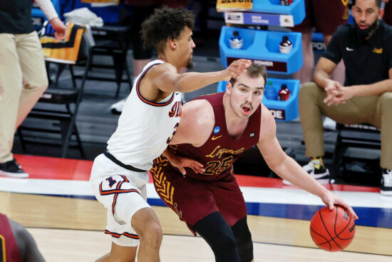 Mar 21, 2021; Indianapolis, Indiana, USA; Loyola Ramblers center Cameron Krutwig (25) dribbles while defended by Illinois Fighting Illini guard Jacob Grandison (3) during the second half in the second round of the 2021 NCAA Tournament at Bankers Life Fieldhouse. Mandatory Credit: Trevor Ruszkowski-USA TODAY Sports