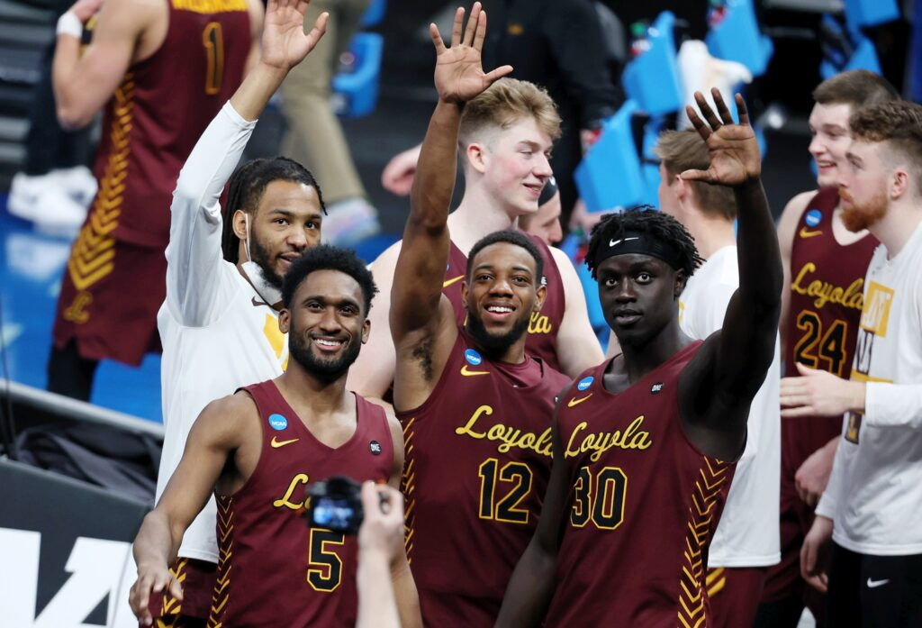 Mar 21, 2021; Indianapolis, Indiana, USA; The Loyola Ramblers wave to Sister Jean after their win over the Illinois Fighting Illini in the second round of the 2021 NCAA Tournament at Bankers Life Fieldhouse. The Loyola Ramblers won 71-58. Mandatory Credit: Trevor Ruszkowski-USA TODAY Sports