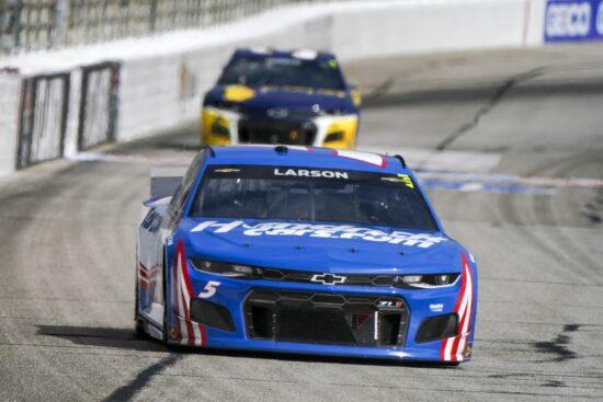Mar 21, 2021; Hampton, Georgia, USA; NASCAR Cup Series driver Kyle Larson (5) leads the race at Atlanta Motor Speedway. Mandatory Credit: Marvin Gentry-USA TODAY Sports