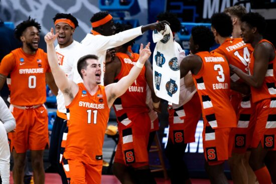Syracuse Orange guard Joseph Girard III (11) and other players celebrate after their 75-72 victory over the West Virginia Mountaineers during the second round of the 2021 NCAA Tournament on Sunday, March 21, 2021, at Bankers Life Fieldhouse in Indianapolis, Ind. Mandatory Credit: Albert Cesare/IndyStar via USA TODAY Sports