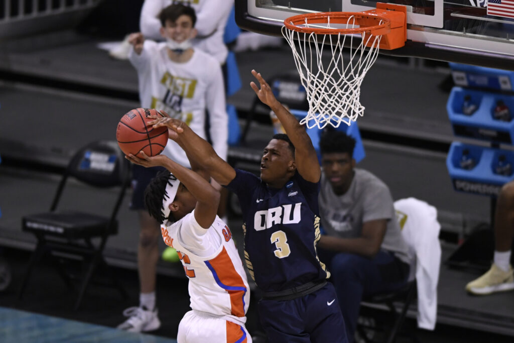 Mar 21, 2021; Indianapolis, IN, USA; Oral Roberts Golden Eagles guard Max Abmas (3) blocks a shot form Florida Gators guard Tyree Appleby (22) in the first half at Indiana Farmers Coliseum. Mandatory Credit: Doug McSchooler-USA TODAY Sports