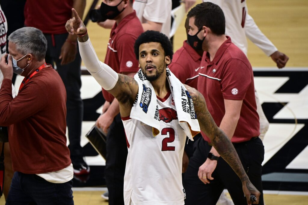 Mar 21, 2021; Indianapolis, Indiana, USA; Arkansas Razorbacks forward Vance Jackson (2) celebrates after defeating the Texas Tech Red Raiders in the second round of the 2021 NCAA Tournament at Hinkle Fieldhouse. Mandatory Credit: Marc Lebryk-USA TODAY Sports