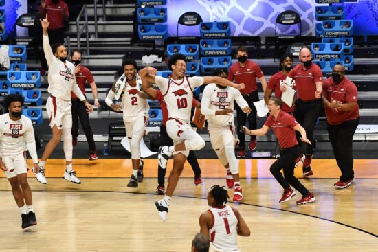 Mar 21, 2021; Indianapolis, Indiana, USA; Arkansas Razorbacks forward Jaylin Williams (10) celebrates with teammates on the court after defeating the Texas Tech Red Raiders in the second round of the 2021 NCAA Tournament at Hinkle Fieldhouse. Mandatory Credit: Patrick Gorski-USA TODAY Sports