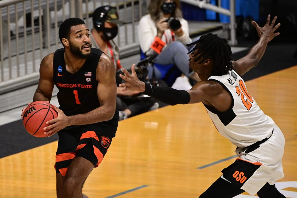 Mar 21, 2021; Indianapolis, Indiana, USA; Oregon State Beavers forward Maurice Calloo (1) looks to pass inbounds while pressured by Oklahoma State Cowboys guard Keylan Boone (20) during the second half in the second round of the 2021 NCAA Tournament at Hinkle Fieldhouse. Mandatory Credit: Marc Lebryk-USA TODAY Sports