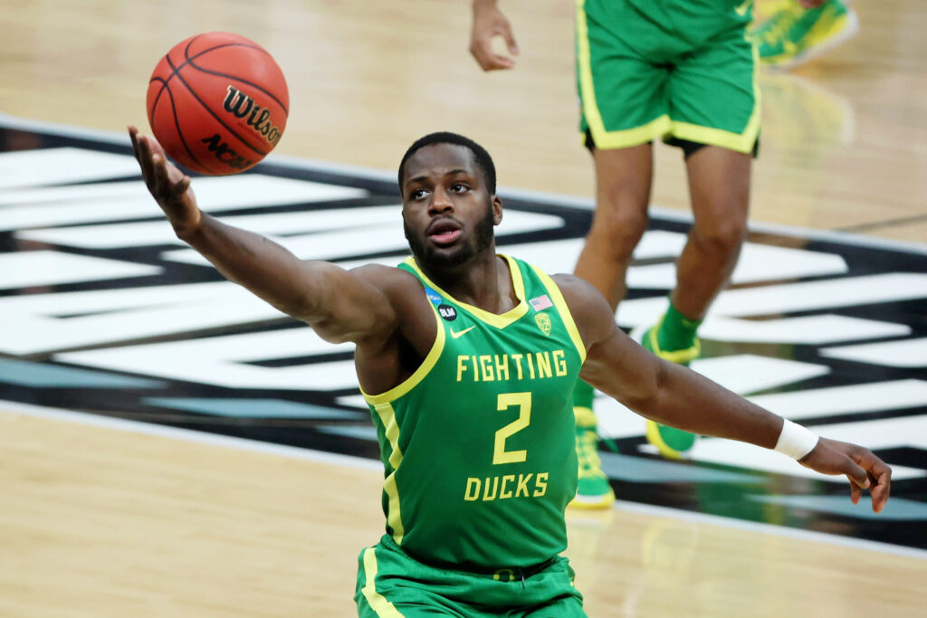 Mar 22, 2021; Indianapolis, Indiana, USA; Oregon Ducks forward Eugene Omoruyi (2) reaches for the ball against the Iowa Hawkeyes during the first half in the second round of the 2021 NCAA Tournament at Bankers Life Fieldhouse. Mandatory Credit: Trevor Ruszkowski-USA TODAY Sports