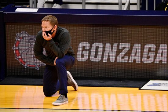Mar 22, 2021; Indianapolis, Indiana, USA; Gonzaga Bulldogs head coach Mark Few kneels as he watches his team play the Oklahoma Sooners during the first half in the second round of the 2021 NCAA Tournament at Hinkle Fieldhouse. Mandatory Credit: Marc Lebryk-USA TODAY Sports