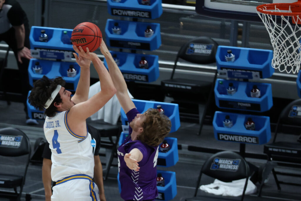 Mar 22, 2021; Indianapolis, Indiana, USA; UCLA Bruins guard Jaime Jaquez Jr. (4) shoots the ball over Abilene Christian Wildcats forward Clay Gayman (42) in the first half in the second round of the 2021 NCAA Tournament at Bankers Life Fieldhouse. Mandatory Credit: Trevor Ruszkowski-USA TODAY Sports