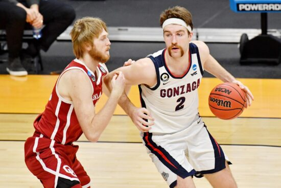 Mar 22, 2021; Indianapolis, Indiana, USA; Gonzaga Bulldogs forward Drew Timme (2) dribbles while fended by Oklahoma Sooners forward Brady Manek (35) during the second half in the second round of the 2021 NCAA Tournament at Hinkle Fieldhouse. The Gonzaga Bulldogs won 87-71. Mandatory Credit: Patrick Gorski-USA TODAY Sports