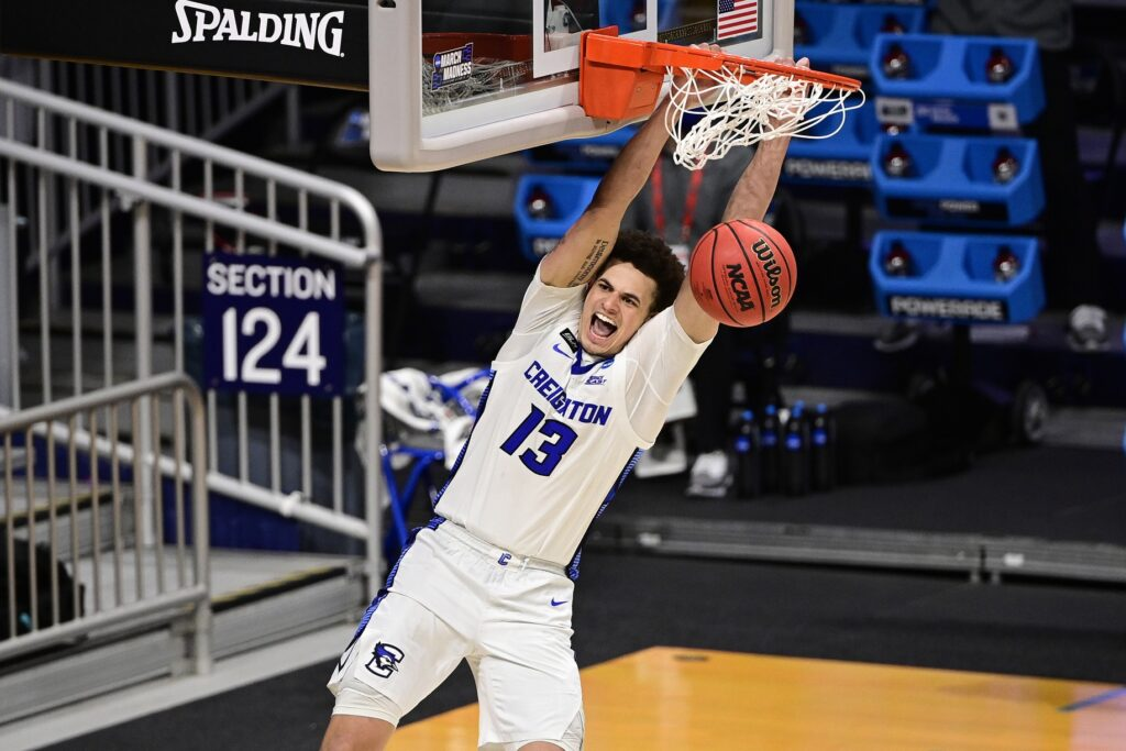Mar 22, 2021; Indianapolis, Indiana, USA; Creighton Bluejays forward Christian Bishop (13) dunks against the Ohio Bobcats in the second half in the second round of the 2021 NCAA Tournament at Hinkle Fieldhouse. Mandatory Credit: Marc Lebryk-USA TODAY Sports