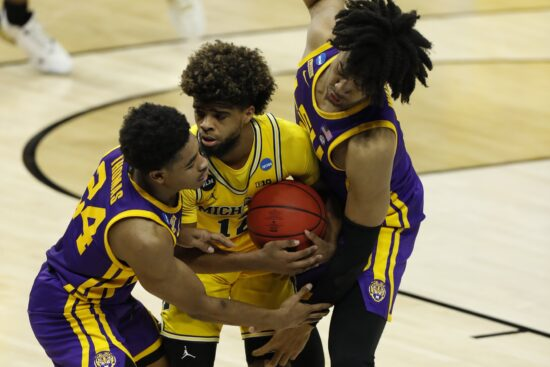 Mar 22, 2021; Indianapolis, Indiana, USA; Louisiana State Tigers guard Cameron Thomas (24) and forward Trendon Watford (2) trap Michigan Wolverines guard Mike Smith (12) on the baseline during the second half in the second round of the 2021 NCAA Tournament at Lucas Oil Stadium. Mandatory Credit: Joshua Bickel-USA TODAY Sports