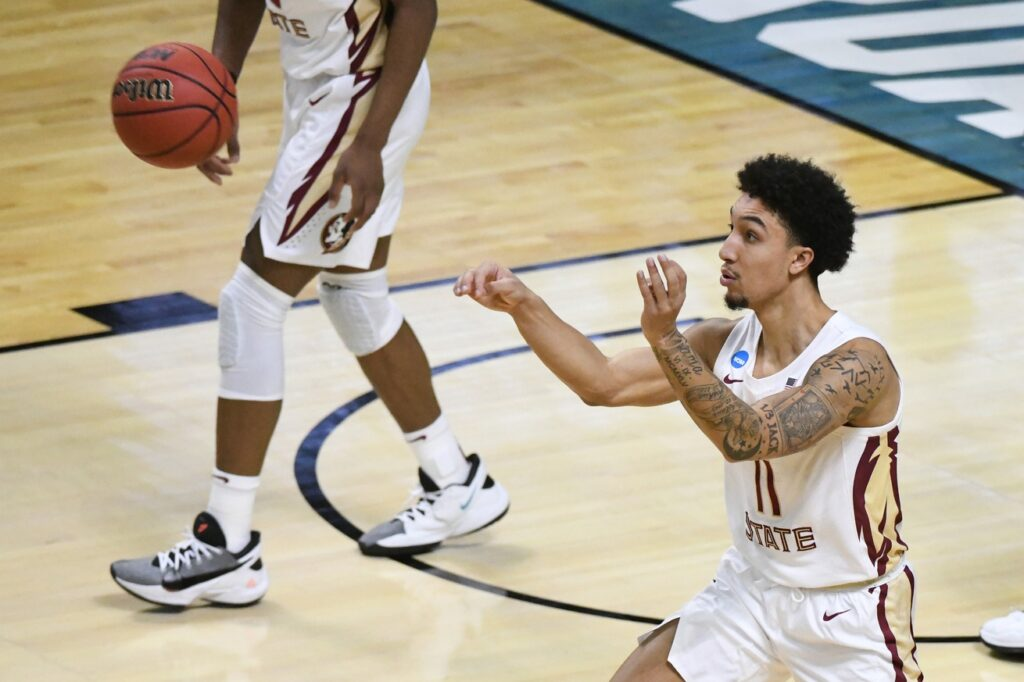 Mar 22, 2021; Indianapolis, Indiana, USA; Florida State Seminoles guard Nathanael Jack (11) passes the ball in the second half against the Colorado Buffaloes in the second round of the 2021 NCAA Tournament at Indiana Farmers Coliseum. Mandatory Credit: Robert Goddin-USA TODAY Sports