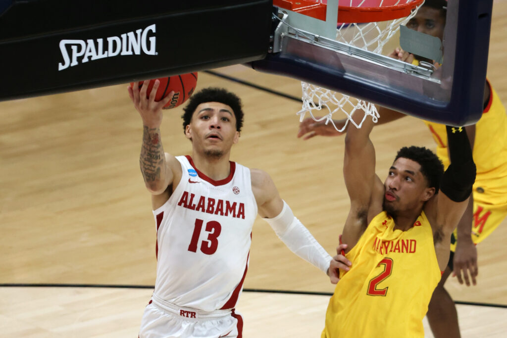 Mar 22, 2021; Indianapolis, Indiana, USA; Alabama Crimson Tide guard Jahvon Quinerly (13) shoots against Maryland Terrapins guard Aaron Wiggins (2) in the second half in the second round of the 2021 NCAA Tournament at Bankers Life Fieldhouse. Mandatory Credit: Trevor Ruszkowski-USA TODAY Sports