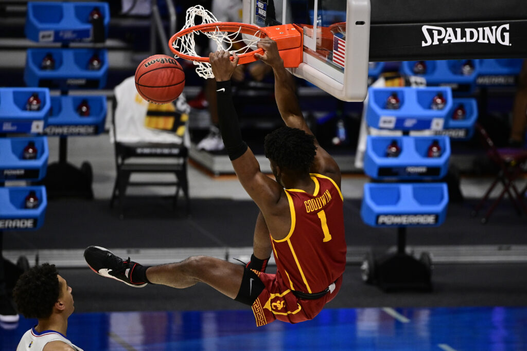 Mar 22, 2021; Indianapolis, Indiana, USA; Southern California Trojans forward Chevez Goodwin (1) hangs on the rim after dunking the ball during the second half in the second round of the 2021 NCAA Tournament against the Kansas Jayhawks at Hinkle Fieldhouse. Mandatory Credit: Marc Lebryk-USA TODAY Sports