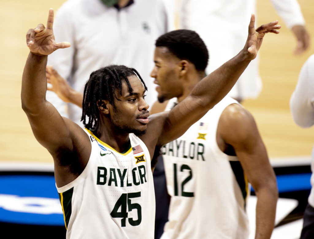 Baylor Bears guard Davion Mitchell (45) celebrates as he leaves the court after defeating Villanova during the Sweet Sixteen round of the 2021 NCAA Tournament on Saturday, March 27, 2021, at Hinkle Fieldhouse in Indianapolis, Ind. Mandatory Credit: Albert Cesare/IndyStar via USA TODAY Sports