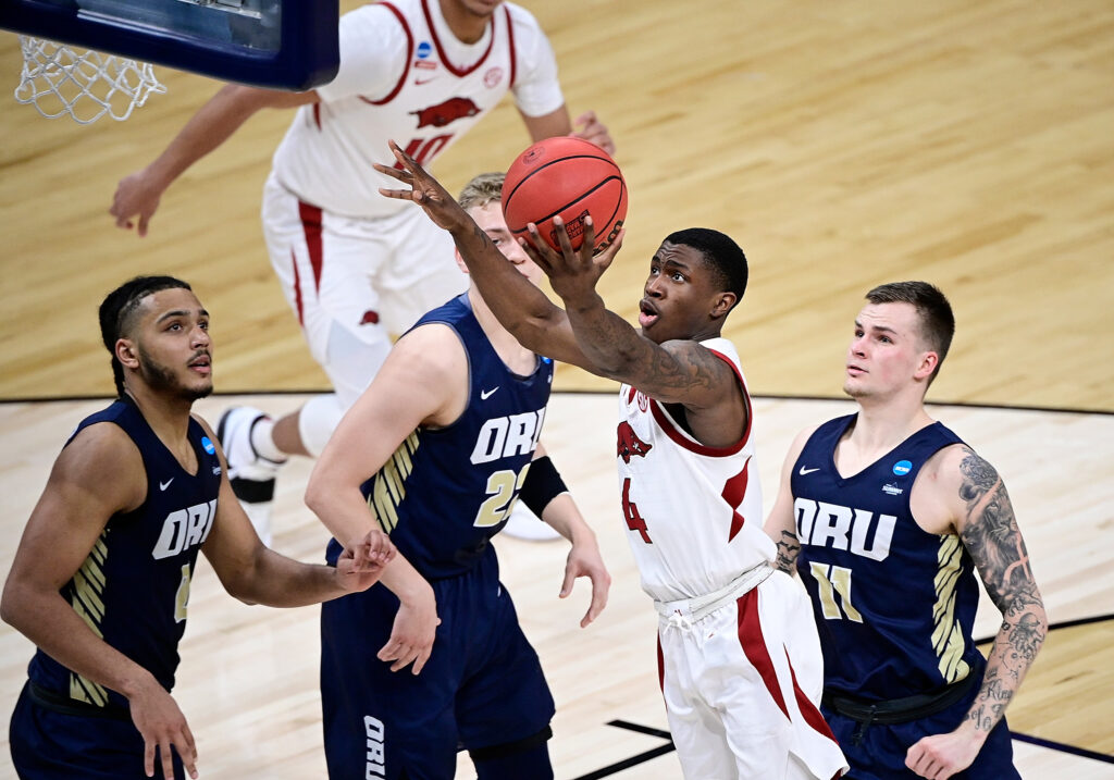Mar 27, 2021; Indianapolis, Indiana, USA; Arkansas Razorbacks guard Davonte Davis (4) drives to the basket during the second half against Oral Roberts Golden Eagles in the Sweet Sixteen of the 2021 NCAA Tournament at Bankers Life Fieldhouse. Mandatory Credit: Marc Lebryk-USA TODAY Sports