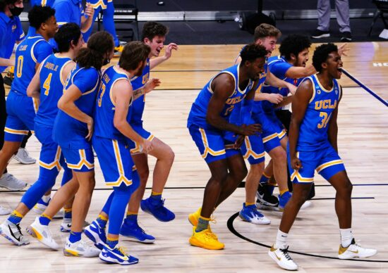 UCLA Bruins celebrates after their win over Alabama Crimson Tide during the Sweet Sixteen round of the 2021 NCAA Tournament on Sunday, March 28, 2021, at Hinkle Fieldhouse in Indianapolis, Ind. UCLA won the overtime game 88-78.Ncaa Basketball Ncaa Tournament Alabama Vs Ucla