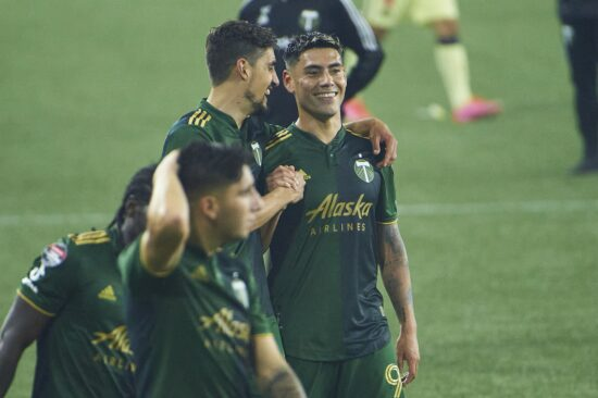 Apr 28, 2021; Portland, Oregon, USA; Portland Timbers defender Jose van Rankin (2) congratulates forward Felipe Mora (9) after a game against Club América at Providence Park. Mora tied the game on a penalty kick. The game ended tied 1-1. Mandatory Credit: Troy Wayrynen-USA TODAY Sports