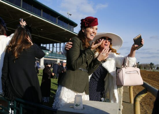Apr 7, 2018; Lexington, KY, USA; Race fans cheer on Jose Ortiz who rode Good Magic after wining the Bluegrass Stakes at Keeneland Racecourse. Mandatory Credit: Mark Zerof-USA TODAY Sports