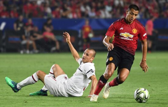 Jul 25, 2018; Carson , CA, USA; Manchester United forward Alexis Sanchez (7) moves the ball away from Milan defender Luca Antonelli (31) in the second half during an International Champions Cup soccer match at Stubhub Center. Mandatory Credit: Robert Hanashiro-USA TODAY Sports