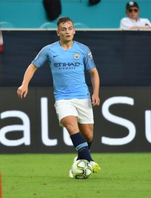 Jul 28, 2018; Miami, FL, USA; Manchester City midfielder Luke Bolton (74) controls the ball against Bayern Munich during the first half of an International Champions Cup soccer match at Hard Rock Stadium. Mandatory Credit: Jasen Vinlove-USA TODAY Sports