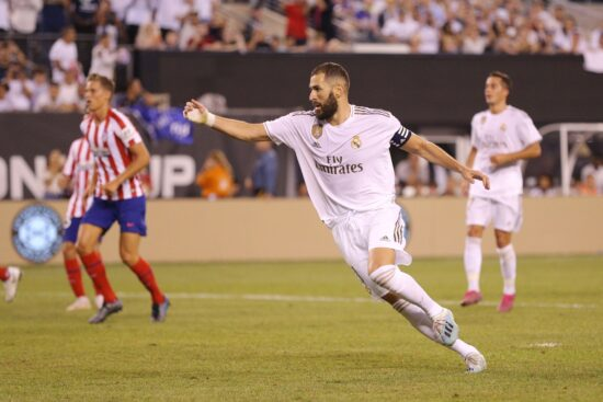 Jul 26, 2019; East Rutherford, NJ, USA; Real Madrid forward Karim Benzema (9) reacts after scoring on a penalty kick against Atletico de Madrid during the second half of an International Champions Cup soccer series match at MetLife Stadium. Mandatory Credit: Brad Penner-USA TODAY Sports